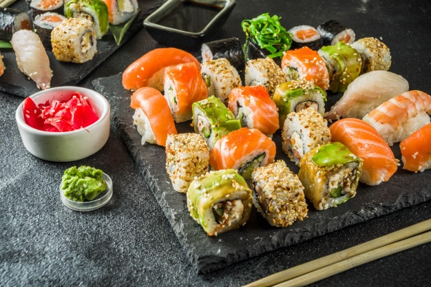 How is sushi served on the table?